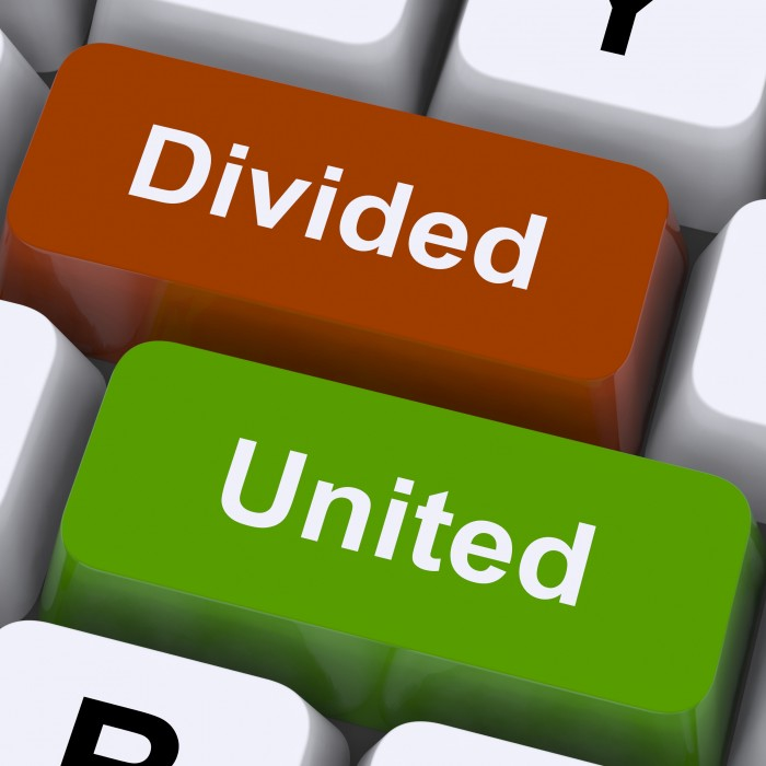 Divided And United Keys Showing Partnership Or Teamwork