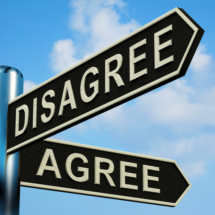 Disagree Or Agree Directions On A Metal Signpost